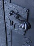 Handles. Old antique metal door handles stock photography