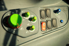 handles of cultivator controls on dashboard in tractor cabin Royalty Free Stock Images