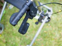 Close up handles of four wheel rollator walkers. Handles of four wheel rollator walkers stock image