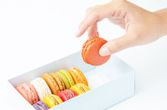 Handles macaroon in the box on white background. Handles macaroon in the box royalty free stock image
