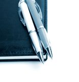 Handles and a notebook Royalty Free Stock Image