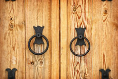 Handles on the old-fashioned wooden door Royalty Free Stock Images