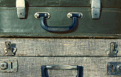 Handles of old suitcases close up. Royalty Free Stock Photography
