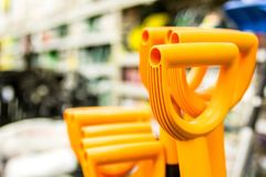 Handles of plastic shovels in the supermarket Stock Photography