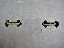 Handles to help with lifting up an iron platform Royalty Free Stock Image