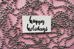 Handlettering words happy holidays and christmas garland Stock Images