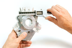 Handling of a caliper. Handling of a digital caliper stock photography