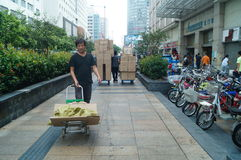Handling of goods, in Shenzhen Huaqiang North Commercial Street Royalty Free Stock Photos