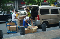 Handling of goods, in Shenzhen Huaqiang North Commercial Street Stock Photos