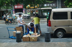 Handling of goods, in Shenzhen Huaqiang North Commercial Street Stock Photography