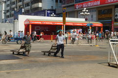Handling of goods, in Shenzhen Huaqiang North Commercial Street Stock Images