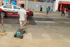 Handling of goods, in Shenzhen Huaqiang North Commercial Street Stock Image