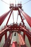 Handling iron ore of the crane Royalty Free Stock Image