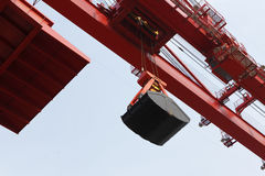 Handling iron ore of the crane Stock Images