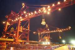 Handling iron ore of the crane Stock Photography
