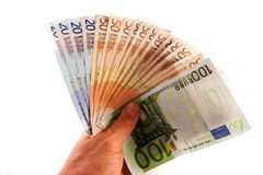 Handling money. Euro banknotes open in a hand royalty free stock image