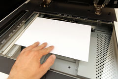 Handling with working laser copier Stock Images