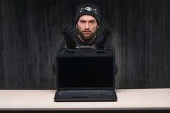 Handlocked computer hakcer. Under arrest. Computer hacker concept Stock Photos