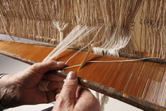Handloom. A person weaving whit a handloom royalty free stock image