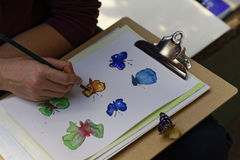 Handmålningfjärilar Arkivbilder
