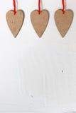 3 handmade сердца на белой предпосылке стены Стоковая Фотография RF