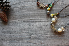 Handmade accessories. Beads colorful on the wooden background royalty free stock images
