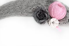Handmade accessories. Gray crocheted material and pink clew, flower Royalty Free Stock Photography