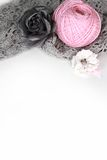 Handmade accessories. Gray crocheted material and pink clew, flower Royalty Free Stock Image