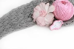 Handmade accessories. Gray crocheted material and pink clew, flower and bird Stock Photo