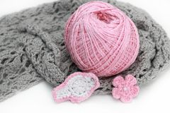 Handmade accessories. Gray crocheted material and pink clew, flower and bird Stock Photography