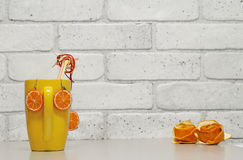 Handmade adornment orange. Handmade adornment from polymer clay on the gray wall background Stock Images