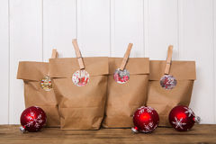 Handmade advent calendar with paper bags and clothes peg. Stock Photography