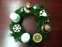 Handmade Advent wreath with gold and white candles stock image