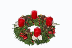 Handmade advent wreath with red candles, cones, rose hip and hea. Rts, isolated on white stock image