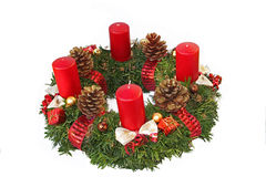 Handmade advent wreath with red ribbon and golden glittering con Stock Photography
