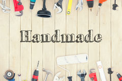 Handmade against diy tools on wooden background Royalty Free Stock Photography