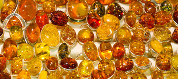 Handmade amber rings Stock Image