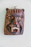 Handmade animal mask hanging on the wall. Handmade typical American mexican mask Royalty Free Stock Photography