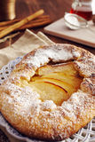 Handmade apple pie. On a dish over a napkin in a country style, cinnamon and hony in the background Stock Photo