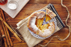 Handmade apple pie. On a dish over a napkin in a country style, cinnamon and hony in the background Stock Images