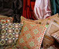 Handmade Arabian Pillows. Handmade Arabian embroidered throw pillows and silk cloth Royalty Free Stock Images