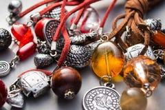 Handmade Artisan Jewellery with Fashionable Charms Stock Photography