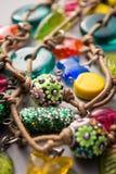 Handmade Artisan Jewellery with Playful Charms Royalty Free Stock Photography