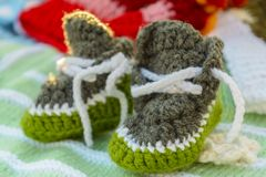 Knitted baby booties. Handmade knitted baby booties, exposed for sale Royalty Free Stock Image