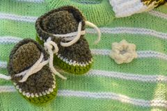 Knitted baby booties. Handmade, knitted baby booties, exposed for sale Stock Photo