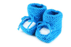 Handmade baby booties isolated on white Royalty Free Stock Photo