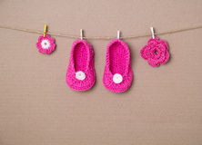 Handmade baby socks. Pink baby socks and flowers Stock Photography
