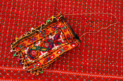 A handmade bag on the traditional rug. Stock Images