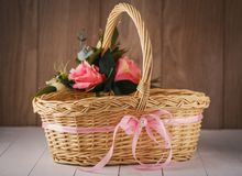 Handmade bamboo basket decorated with flowers Royalty Free Stock Photos