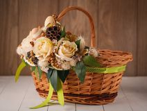 Handmade bamboo basket decorated with flowers Stock Images